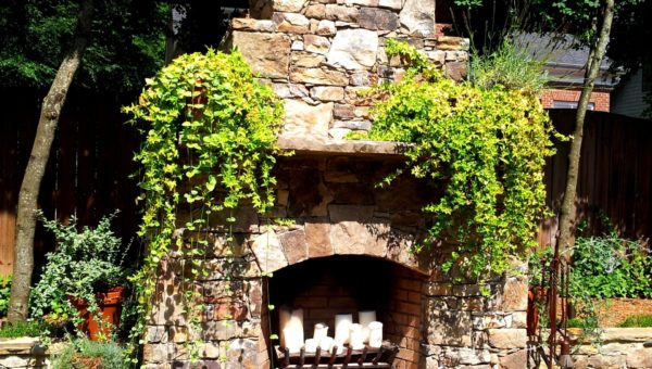 Installation of outdoor stone fireplace design in Charlotte, NC by Charlotte Pavers & Stone.