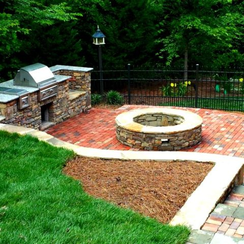 outdoor kitchen-stone fire=pit-paver-patio